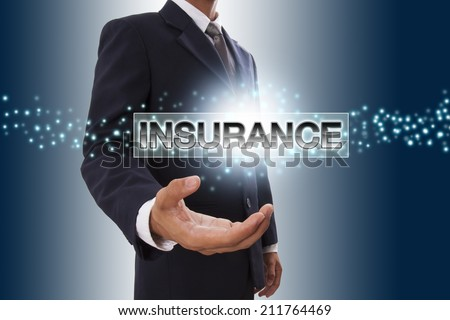 Businessman hand showing insurance button on virtual screen. - stock photo
