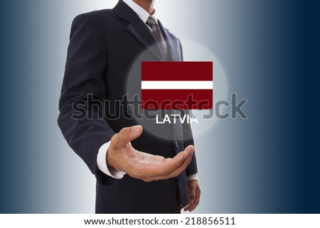 Businessman hand showing Latvia Flag