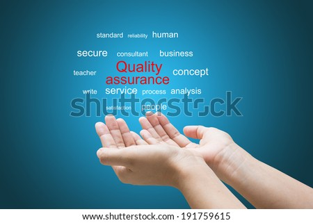 Businessman Hand Showing quality assurance Word  - stock photo