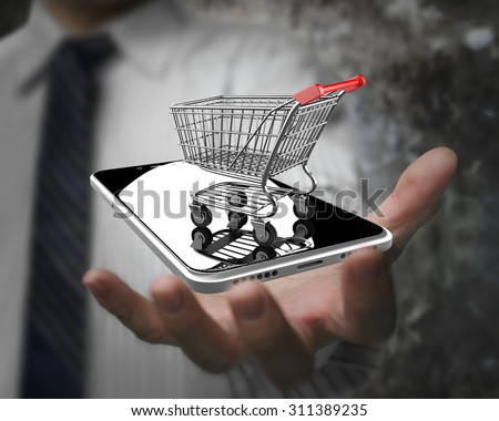 Businessman hand showing shopping cart with smart phone, on line shopping concept. - stock photo