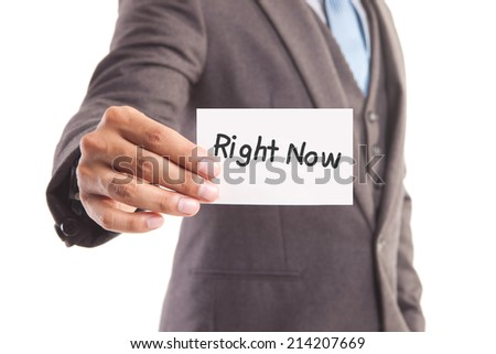 "Businessman hand showing someone his business card with""right now"" message"