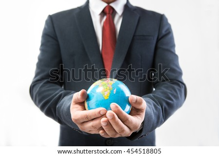 businessman hand showing texture the world on screen city scape background with network diagram concept