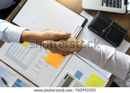Businessman hand together Handshake for business project teamwork , business people deal success