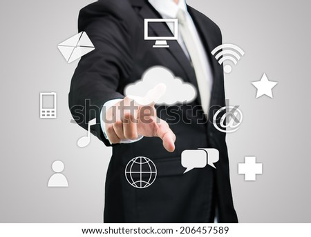 Businessman hand touch cloud computing concept on gray background - stock photo