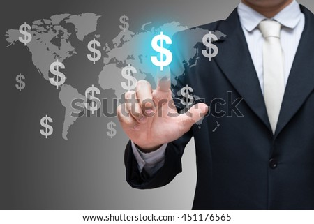 Businessman hand touch financial symbols on gray background