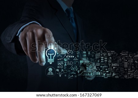 businessman hand touch light bulb sign and business strategy as concept - stock photo