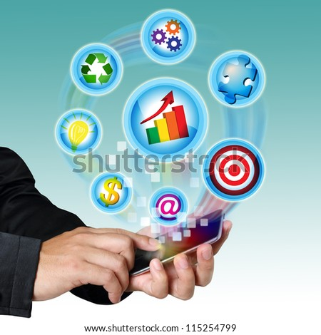 Businessman hand touch screen mobile with business symbols icons. - stock photo