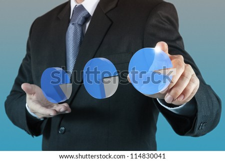 businessman  hand touch virtual pie chart. - stock photo