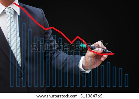 Businessman hand touching a graph indicating growth