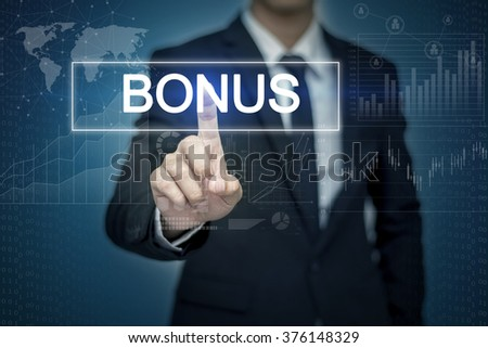 Businessman hand touching BONUS button on virtual screen