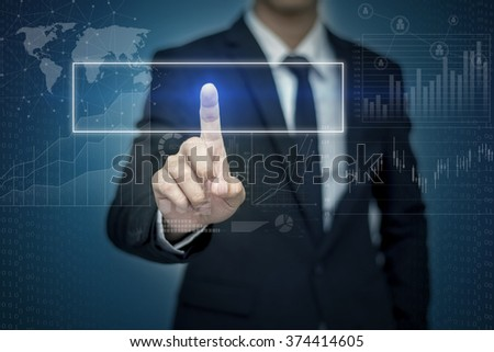 Businessman hand touching  button on virtual screen - stock photo