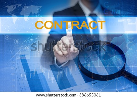 Businessman hand touching CONTRACT button on virtual screen