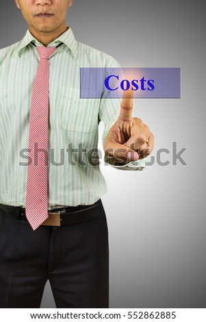 Businessman hand touching Costs message on virtual screen