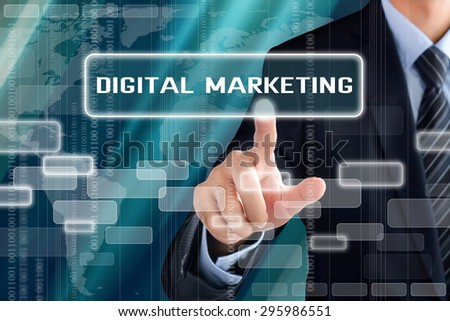 Businessman hand touching DIGITAL MARKETING sign on virtual screen - stock photo