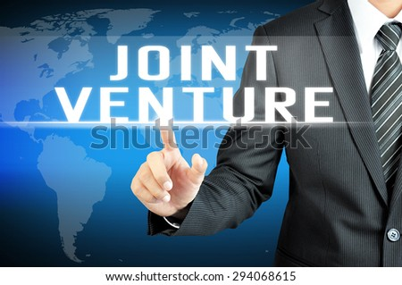 Businessman hand touching JOINT VENTURE sign on virtual screen