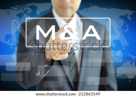 Businessman hand touching M & A on virtual screen - merger & acquisition concept - stock photo