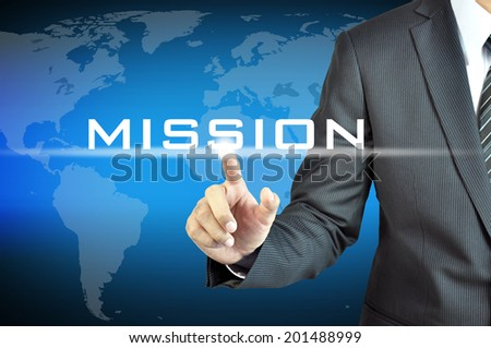 Businessman hand touching MISSION sign on virtual screen