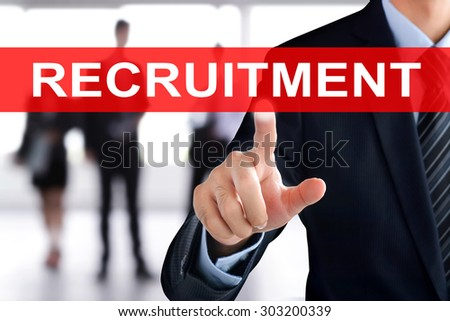 Businessman hand touching  RECRUITMENT sign on virtual screen - stock photo