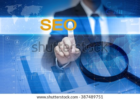 Businessman hand touching SEO button on virtual screen