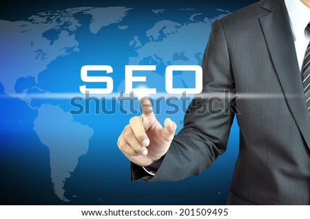 Businessman hand touching SEO (or Search Engine Optimization) sign on virtual screen - internet & online marketing concept - stock photo