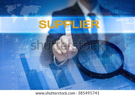 Businessman hand touching SUPPLIER button on virtual screen - stock photo