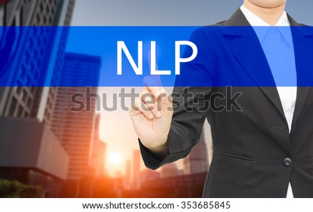 Businessman hand touching Text NLP  ( Neuro Linguistic Programming) on virtual screen,Background city - stock photo