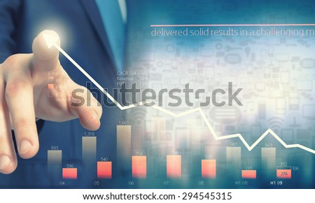 Businessman hand touching virtual graph on media screen