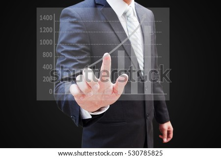 Businessman hand touching virtual panel of bar chart , business concept