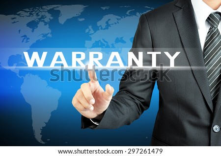 Businessman hand touching WARRANTY sign on virtual screen