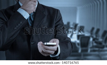 businessman hand use smart phone computer as concept - stock photo