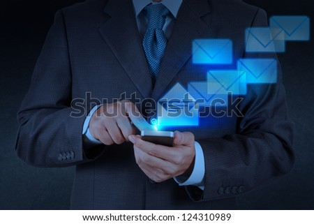 businessman hand use smart phone computer with email icon - stock photo