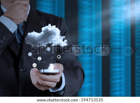 Businessman hand using mobile phone with  Cloud Computing diagram on the new computer interface as concept - stock photo