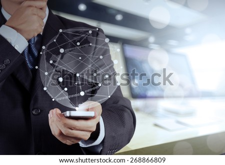 Businessman hand using  mobile phone with social network diagram on wooden desk as concept - stock photo