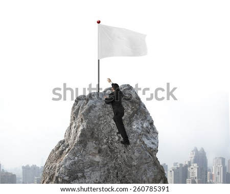 Businessman hand wanting for victory white flag on mountain peak with sky cityscape background - stock photo