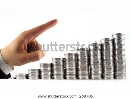 businessman hand with coins showing increasing of profits - stock photo