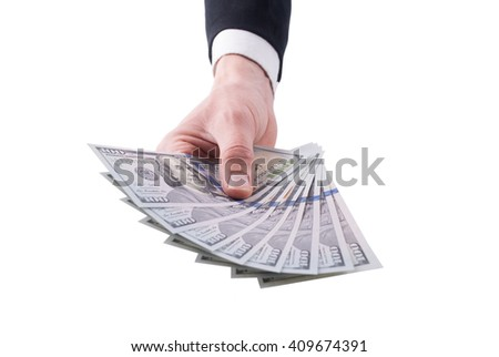 Businessman hand with money isolated on white background. - stock photo