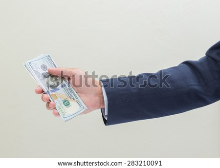 Businessman hand with money, United stage dollar bill