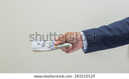 Businessman hand with money, United stage dollar bill - stock photo