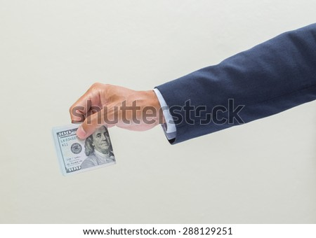 Businessman hand with money, United stage dollar bill isolated on white background with clipping path