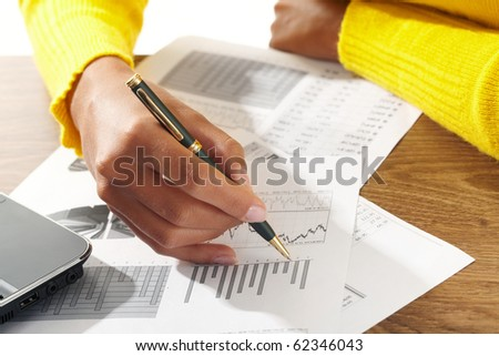 businessman hand with pen - stock photo