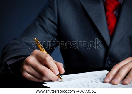 businessman hand with pen signing contract - stock photo