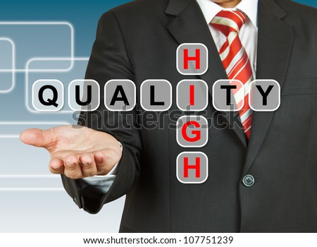 Businessman hand with text High Quality - stock photo
