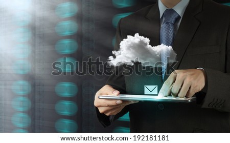 Businessman hand working with email icon and Cloud Computing diagram on the new computer interface as concept - stock photo