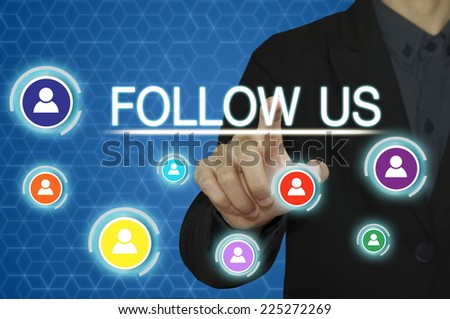 businessman hand working with  modern computer and pressing follow us button. - stock photo