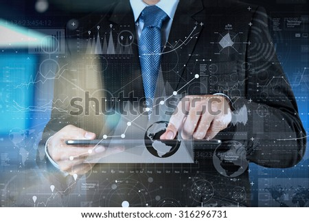 businessman hand working with modern technology and digital layer effect as business strategy concept - stock photo