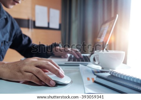 businessman hand working with modern technology and digital layer effect as business strategy concept in morning light - stock photo