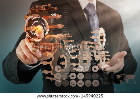 businessman hand working with new computer interface show gear to success as teamwork concept - stock photo