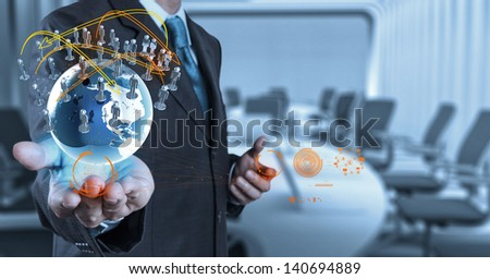businessman hand working with new modern computer show the earth social network structure - stock photo