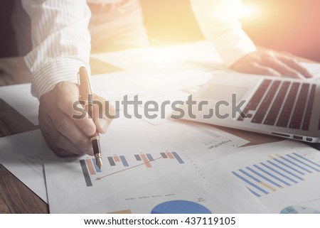 businessman hand working with new modern computer smartphone and graph business with social network diagram and pointing graphs and charts being demonstrated of grow business,selective focus,vintage - stock photo