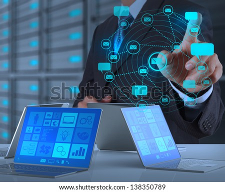 businessman hand working with the new computer shows internet and social network as concept - stock photo